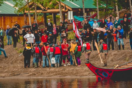 people gathered at lake shore after canoeing.jpg