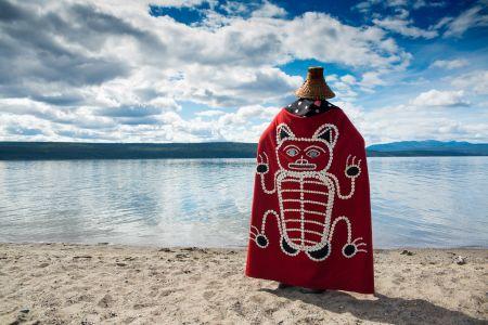Chief Sidney in blanket by lake shore.jpg