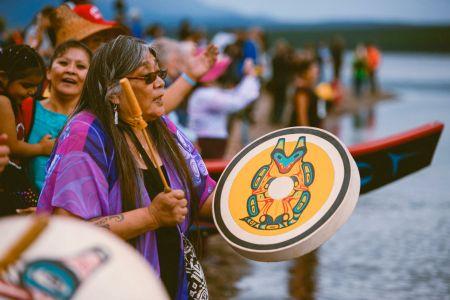 Georgina Sydney drumming canoes  to shore.jpg