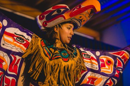 Woman with eagle head piece dancing.jpg